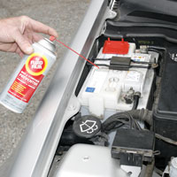 Man applying Fluid Film on Automobile battery terminal