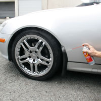 Man applying Fluid Film on Automobile chrome